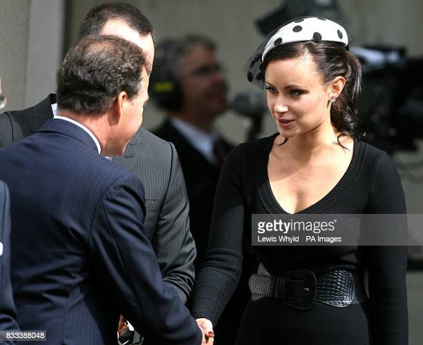 Camilla Al Fayed is greeted by Viscount Linley after the Service of Thanksgiving for the life of Diana Princess of Wales at the Guards' Chapel London...