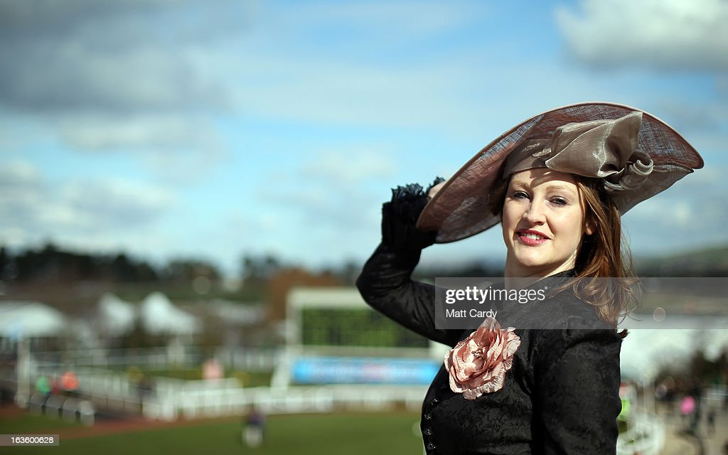 Camilla Bassett-Smith poses for a photograph as she arrives for Ladies Day at Cheltenham Racecourse on the second day of the Cheltenham Festival 2013 on March 13, 2013 in Cheltenham, England. Approximately 200,000 racing enthusiasts are expected at the four-day festival, which opened yesterday and is seen by many as the highlight of the jump racing calendar.