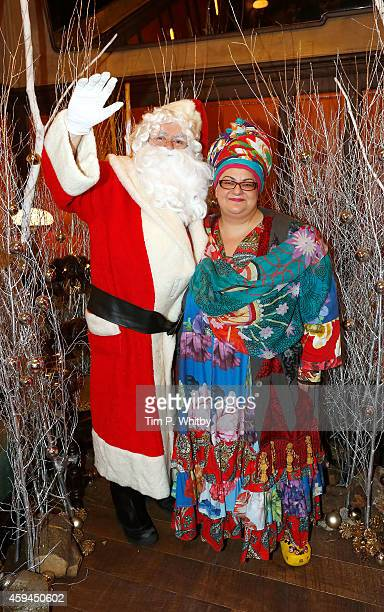 Camilla Batmanghelidgh poses for a photo with Father Christmas at the brunch launch of The Ivy Market Grill in partnership with the Kids Company at...