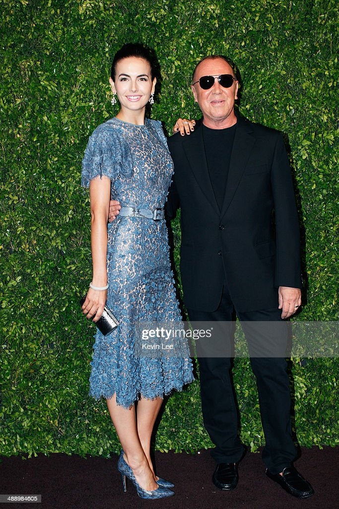 Camilla Bella and Michael Kors poses for a picture at the Michael Kors fashion show on May 9, 2014 in Shanghai, China.