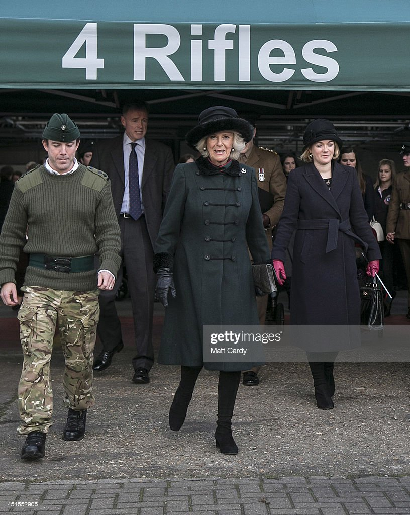 Camilla, Duchess of Cornwall (C) accompanied by CO 4 RIFLES, Lt Col Tom Bewick (L) arrives to present medals to soldiers from the 4th Battalion The Rifles to mark their return from Afghanistan, at their barracks in Bulford on December 9, 2013 in Wiltshire, England.