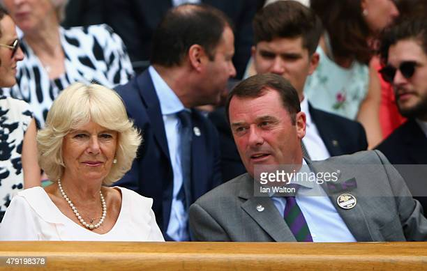 Camilla Duchess of Cornwall and AELTC Chairman Phiip Brook look on from Centre Court during day four of the Wimbledon Lawn Tennis Championships at...