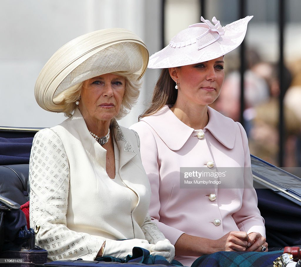 Camilla, Duchess of Cornwall and Catherine, Duchess of Cambridge leave Buckingham Palace in a horse drawn carriage to attend the annual Trooping the Colour Ceremony on June 15, 2013 in London, England. Today's ceremony which marks the Queen's official birthday will not be attended by Prince Philip the Duke of Edinburgh as he recuperates from abdominal surgery. This will also be The Duchess of Cambridge's last public engagement before her baby is due to be born next month.