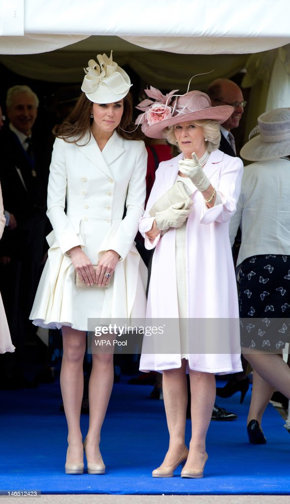 <a gi-track='captionPersonalityLinkClicked' href=/galleries/search?phrase=Camilla+-+Duchess+of+Cornwall&family=editorial&specificpeople=158157 ng-click='$event.stopPropagation()'>Camilla</a>, Duchess of Cornwall and Catherine, Duchess of Cambridge watch the Order of the Garter procession at Windsor Castle on June 18, 2011 in Windsor, England. The Order of the Garter is the senior and oldest British Order of Chivalry, founded by Edward III in 1348. Membership in the order is limited to the sovereign, the Prince of Wales, and no more than twenty-four members.