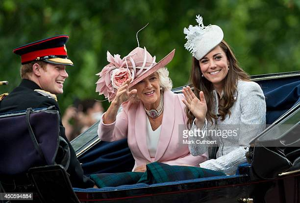 Camilla Duchess of Cornwall and Catherine Duchess of Cambridge with Prince Harry travel by carriage during Trooping the Colour at The Royal...
