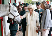 Camilla Duchess of Cornwall and First Lady of Colombia Maria Clemencia Rodriguez Munera meets horses as they visits Escuela de Cabelleria del...