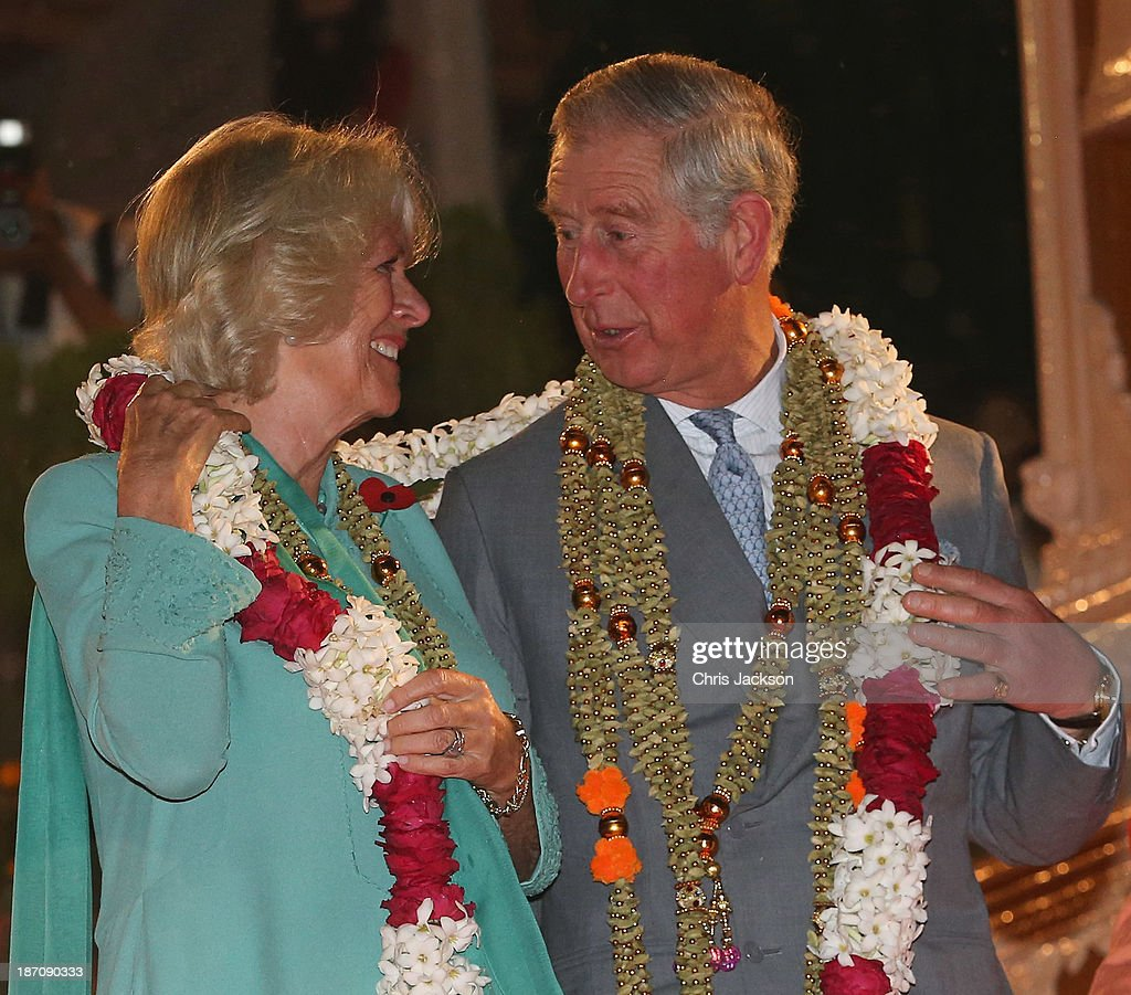 <a gi-track='captionPersonalityLinkClicked' href=/galleries/search?phrase=Camilla+-+Duchess+of+Cornwall&family=editorial&specificpeople=158157 ng-click='$event.stopPropagation()'>Camilla</a>, Duchess of Cornwall and <a gi-track='captionPersonalityLinkClicked' href=/galleries/search?phrase=Prince+Charles+-+Prince+of+Wales&family=editorial&specificpeople=160180 ng-click='$event.stopPropagation()'>Prince Charles</a>, Prince of Wales are presented with a gift as they take part in an Aarti ceremony at the Parmarth Niketan Temple on the banks of the River Ganges during day 1 of an official visit to India on November 6, 2013 in Dehradun, India. This will be the Royal couple's third official visit to India together and their most extensive yet, which will see them spending nine days in India and afterwards visiting Sri Lanka in order to attend the 2013 Commonwealth Heads of Government Meeting.