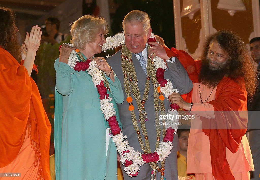 Camilla, Duchess of Cornwall and Prince Charles, Prince of Wales are presented with a gift by Pujya Swami Chidanand Saraswatiji Maharaj as they take part in an Aarti ceremony at the Parmarth Niketan Temple on the banks of the River Ganges during day 1 of an official visit to India on November 6, 2013 in Dehradun, India. This will be the Royal couple's third official visit to India together and their most extensive yet, which will see them spending nine days in India and afterwards visiting Sri Lanka in order to attend the 2013 Commonwealth Heads of Government Meeting. (Photo by Chris Jackson/Getty Images) DEHRA DUN, INDIA - NOVEMBER 06: Camilla, Duchess of Cornwall and Prince Charles, Prince of Wales are presented with a gift by Pujya Swami Chidanand Saraswatiji Maharaj as they take part in an Aarti ceremony at the Parmarth Niketan Temple on the banks of the River Ganges during day 1 of an official visit to India on November 6, 2013 in Dehradun, India. This will be the Royal couple's third official visit to India together and their most extensive yet, which will see them spending nine days in India and afterwards visiting Sri Lanka in order to attend the 2013 Commonwealth Heads of Government Meeting.