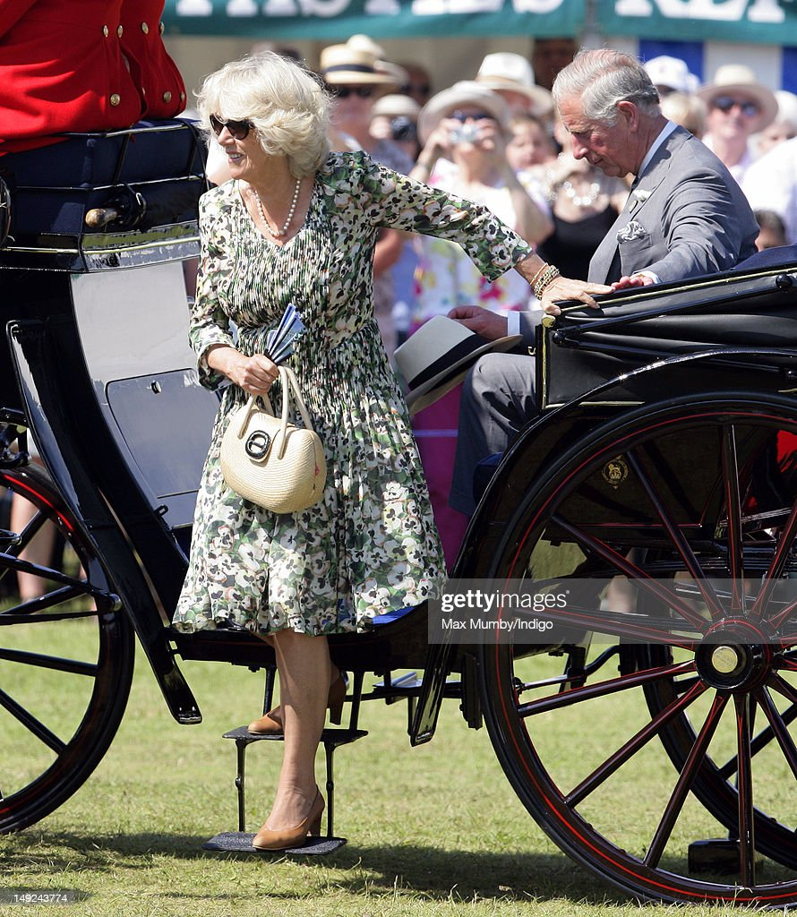Camilla, Duchess of Cornwall and <a gi-track='captionPersonalityLinkClicked' href=/galleries/search?phrase=Prince+Charles+-+Prince+of+Wales&family=editorial&specificpeople=160180 ng-click='$event.stopPropagation()'>Prince Charles</a>, Prince of Wales arrive by horse drawn carriage to tour the Sandringham Flower Show at Sandringham on July 25, 2012 in King's Lynn, England.