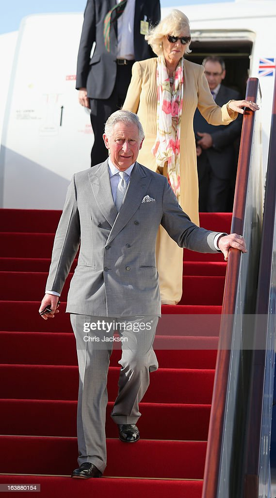 <a gi-track='captionPersonalityLinkClicked' href=/galleries/search?phrase=Camilla+-+Duchess+of+Cornwall&family=editorial&specificpeople=158157 ng-click='$event.stopPropagation()'>Camilla</a>, Duchess of Cornwall and <a gi-track='captionPersonalityLinkClicked' href=/galleries/search?phrase=Prince+Charles&family=editorial&specificpeople=160180 ng-click='$event.stopPropagation()'>Prince Charles</a>, Prince of Wales arrive at Oman International Airport on the seventh day of a tour of the Middle East on March 17, 2013 in Muscat, Oman. The Royal couple are on the fourth and final leg of a tour of the Middle East taking in Jordan, Qatar, Saudia Arabia and Oman.