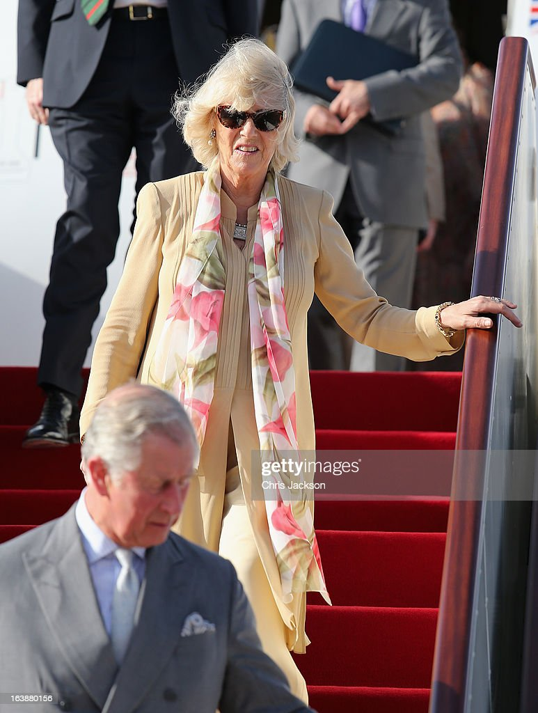 <a gi-track='captionPersonalityLinkClicked' href=/galleries/search?phrase=Camilla+-+Duchess+of+Cornwall&family=editorial&specificpeople=158157 ng-click='$event.stopPropagation()'>Camilla</a>, Duchess of Cornwall and <a gi-track='captionPersonalityLinkClicked' href=/galleries/search?phrase=Prince+Charles+-+Prince+of+Wales&family=editorial&specificpeople=160180 ng-click='$event.stopPropagation()'>Prince Charles</a>, Prince of Wales arrive at Oman International Airport on the seventh day of a tour of the Middle East on March 17, 2013 in Muscat, Oman. The Royal couple are on the fourth and final leg of a tour of the Middle East taking in Jordan, Qatar, Saudia Arabia and Oman.