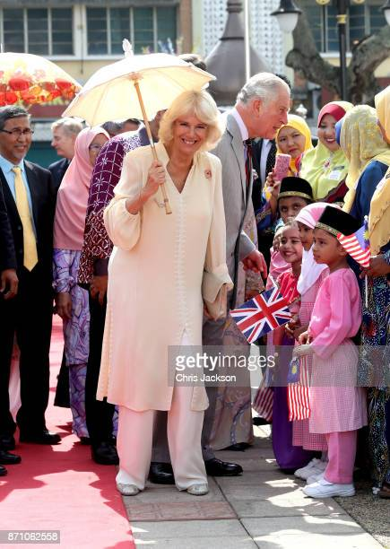 Camilla Duchess of Cornwall and Prince Charles Prince of Wales arrive at the Kapitan Keling Mosque on November 7 2017 in George Town Penang Malaysia...