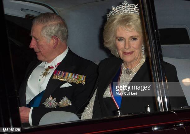 Camilla Duchess of Cornwall and Prince Charles Prince of Wales arrive at a Diplomatic Reception at Buckingham Palace on December 5 2017 in London...