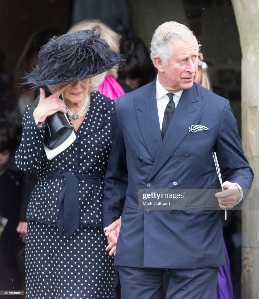 <a gi-track='captionPersonalityLinkClicked' href=/galleries/search?phrase=Camilla+-+Duchess+of+Cornwall&family=editorial&specificpeople=158157 ng-click='$event.stopPropagation()'>Camilla</a>, Duchess of Cornwall and <a gi-track='captionPersonalityLinkClicked' href=/galleries/search?phrase=Prince+Charles&family=editorial&specificpeople=160180 ng-click='$event.stopPropagation()'>Prince Charles</a>, Prince of Wales attend The Funeral of Mark Shand at Holy Trinity Church in Stourpaine on May 1, 2014 near Blandford Forum in Dorset, England.