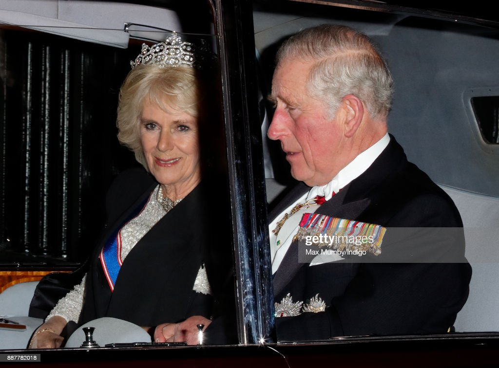 Camilla, Duchess of Cornwall and Prince Charles, Prince of Wales depart after attending the annual Diplomatic Reception at Buckingham Palace on December 5, 2017 in London, England.