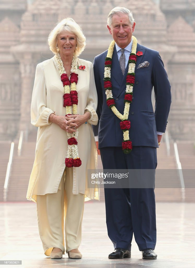 <a gi-track='captionPersonalityLinkClicked' href=/galleries/search?phrase=Camilla+-+Duchess+of+Cornwall&family=editorial&specificpeople=158157 ng-click='$event.stopPropagation()'>Camilla</a>, Duchess of Cornwall and <a gi-track='captionPersonalityLinkClicked' href=/galleries/search?phrase=Prince+Charles&family=editorial&specificpeople=160180 ng-click='$event.stopPropagation()'>Prince Charles</a>, Prince of Wales pose outside the Akshardham Temple during day 3 of an official visit to India on November 8, 2013 in Delhi, India. This will be the Royal couple's third official visit to India together and their most extensive yet, which will see them spending nine days in India and afterwards visiting Sri Lanka in order to attend the 2013 Commonwealth Heads of Government Meeting.