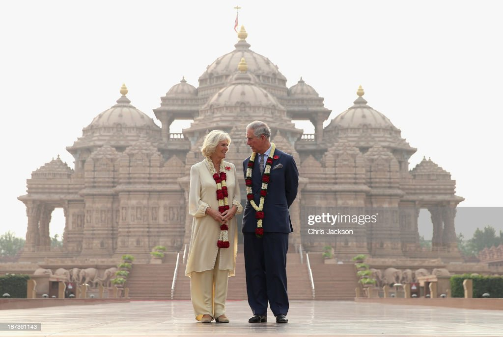 <a gi-track='captionPersonalityLinkClicked' href=/galleries/search?phrase=Camilla+-+Duchess+of+Cornwall&family=editorial&specificpeople=158157 ng-click='$event.stopPropagation()'>Camilla</a>, Duchess of Cornwall and <a gi-track='captionPersonalityLinkClicked' href=/galleries/search?phrase=Prince+Charles+-+Prince+of+Wales&family=editorial&specificpeople=160180 ng-click='$event.stopPropagation()'>Prince Charles</a>, Prince of Wales pose outside the Akshardham Temple during day 3 of an official visit to India on November 8, 2013 in Delhi, India. This will be the Royal couple's third official visit to India together and their most extensive yet, which will see them spending nine days in India and afterwards visiting Sri Lanka in order to attend the 2013 Commonwealth Heads of Government Meeting.