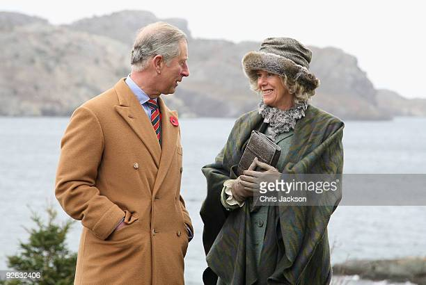 TRH Camilla Duchess of Cornwall and Prince Charles Prince of Wales pose for a photgraph as she visits the historic town of Brigus on November 3 2009...