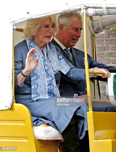 Camilla Duchess of Cornwall and Prince Charles Prince of Wales ride in a rickshaw at Clarence House on March 26 2015 in London England In November...