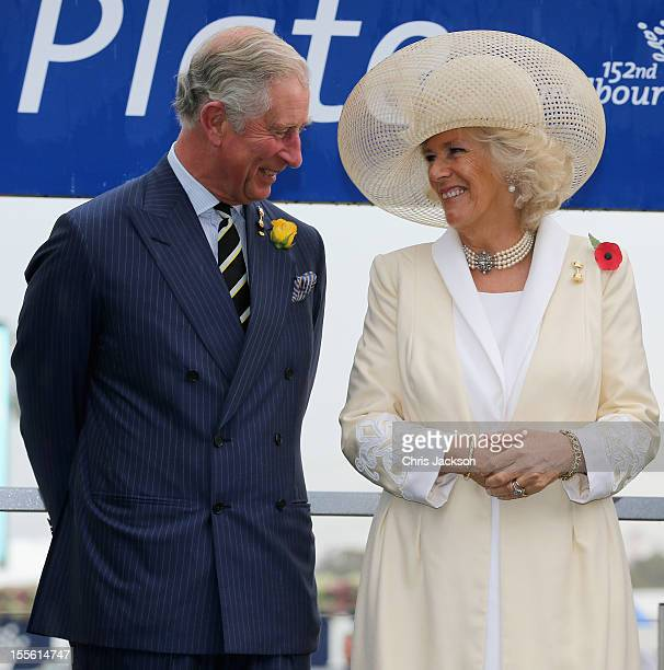 Camilla Duchess of Cornwall and Prince Charles Prince of Wales share a joke as they attend the 2012 Melbourne Cup at Flemington Racecourse on...
