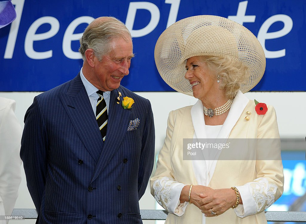 Camilla Duchess of Cornwall and Prince Charles Prince of Wales share a joke after presenting the Diamond Jubilee Plate to the winning horse owner Mr...