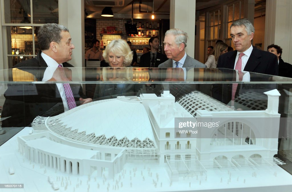 Camilla, Duchess of Cornwall and Prince Charles, Prince of Wales (2nd R) study a model of the refurbished King's Cross Rail Station, during a visit to the terminal as they mark 150 years of London Underground on January 30, 2013 in London, England.