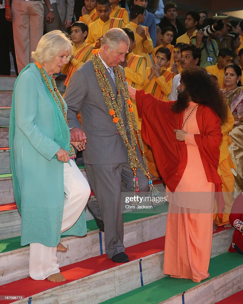 Camilla, Duchess of Cornwall and Prince Charles, Prince of Wales take part in an Aarti ceremony lead by Pujya Swami Chidanand Saraswatiji Maharaj at the Parmarth Niketan Temple on the banks of the River Ganges during day 1 of an official visit to India on November 6, 2013 in Dehradun, India. This will be the Royal couple's third official visit to India together and their most extensive yet, which will see them spending nine days in India and afterwards visiting Sri Lanka in order to attend the 2013 Commonwealth Heads of Government Meeting.