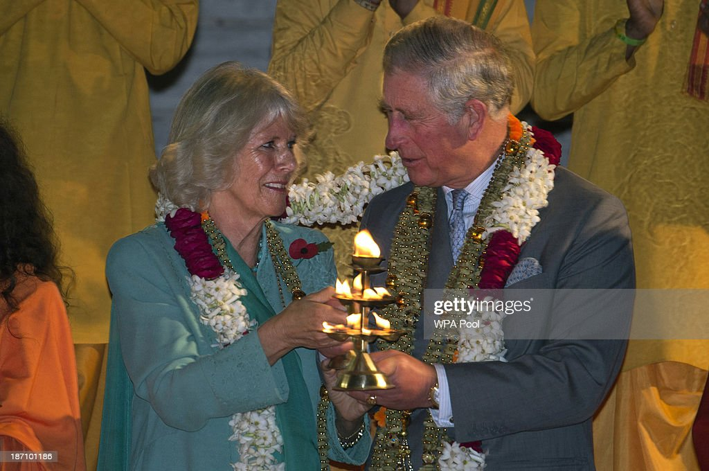 Camilla, Duchess of Cornwall and Prince Charles, Prince of Wales take part in an Aarti ceremony lead at the Parmarth Niketan Temple on the banks of the River Ganges during day 1 of an official visit to India on November 6, 2013 in Rishikesh, India. This will be the Royal couple's third official visit to India together and their most extensive yet, which will see them spending nine days in India and afterwards visiting Sri Lanka in order to attend the 2013 Commonwealth Heads of Government Meeting.