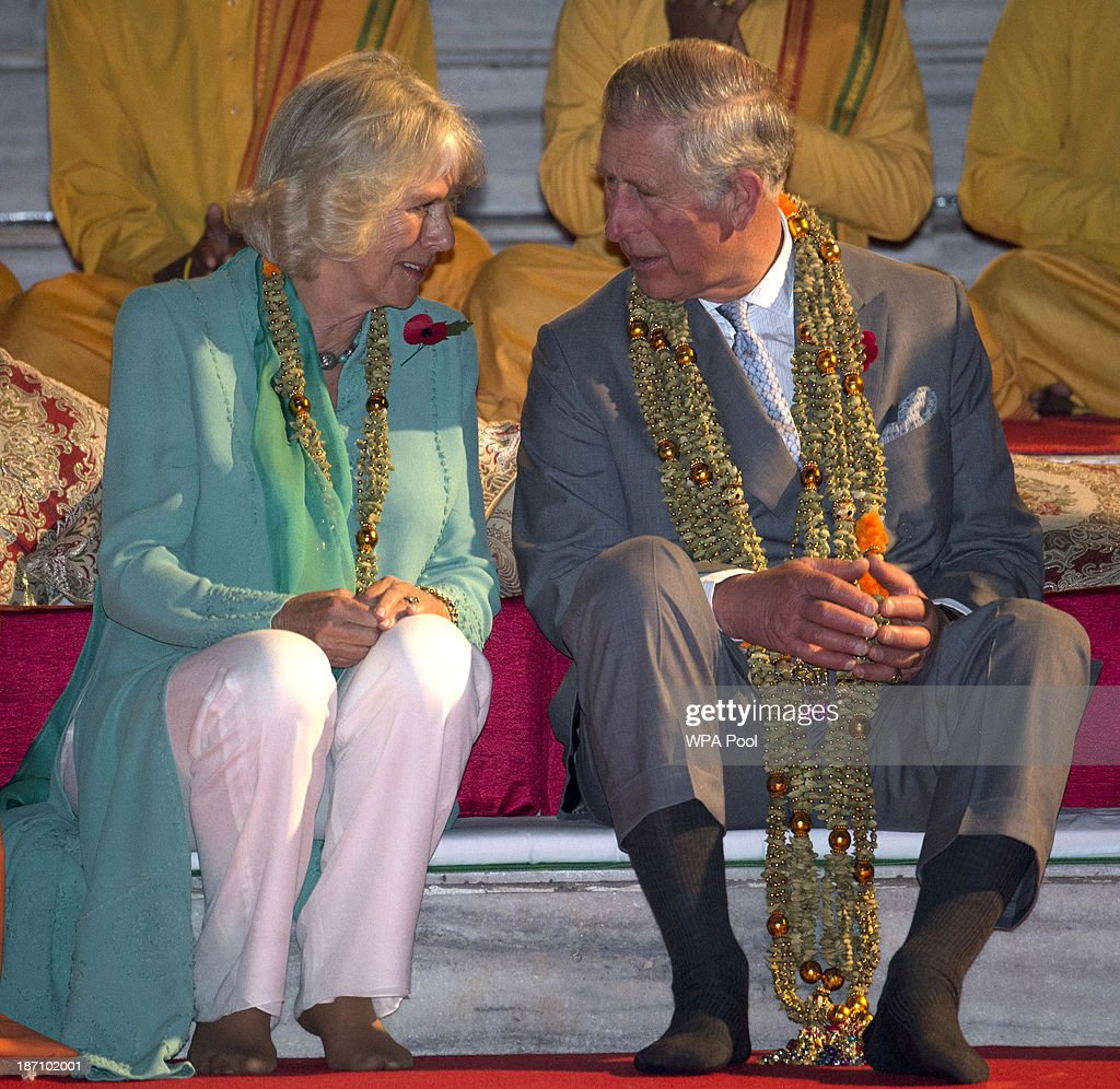 Camilla, Duchess of Cornwall and Prince Charles, Prince of Wales take part in an Aarti ceremony at the Parmarth Niketan Temple on the banks of the River Ganges during day 1 of an official visit to India on November 6, 2013 in Rishikesh, India. This will be the Royal couple's third official visit to India together and their most extensive yet, which will see them spending nine days in India and afterwards visiting Sri Lanka in order to attend the 2013 Commonwealth Heads of Government Meeting.