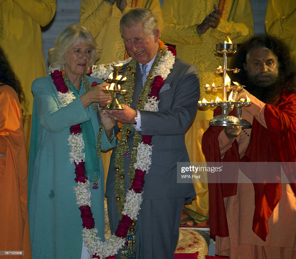 Camilla, Duchess of Cornwall and Prince Charles, Prince of Wales take part in an Aarti ceremony lead by Pujya Swami Chidanand Saraswatiji Maharaj (R) at the Parmarth Niketan Temple on the banks of the River Ganges during day 1 of an official visit to India on November 6, 2013 in Rishikesh, India. This will be the Royal couple's third official visit to India together and their most extensive yet, which will see them spending nine days in India and afterwards visiting Sri Lanka in order to attend the 2013 Commonwealth Heads of Government Meeting.