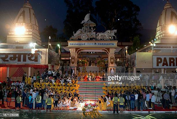Camilla Duchess of Cornwall and Prince Charles Prince of Wales take part in an Aarti ceremony at the Parmarth Niketan Temple on the banks of the...