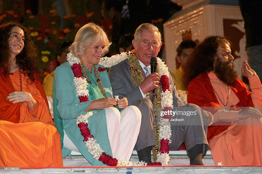 <a gi-track='captionPersonalityLinkClicked' href=/galleries/search?phrase=Camilla+-+Duchess+of+Cornwall&family=editorial&specificpeople=158157 ng-click='$event.stopPropagation()'>Camilla</a>, Duchess of Cornwall and <a gi-track='captionPersonalityLinkClicked' href=/galleries/search?phrase=Prince+Charles+-+Prince+of+Wales&family=editorial&specificpeople=160180 ng-click='$event.stopPropagation()'>Prince Charles</a>, Prince of Wales take part in an Aarti ceremony at the Parmarth Niketan Temple on the banks of the River Ganges during day 1 of an official visit to India on November 6, 2013 in Dehradun, India. This will be the Royal couple's third official visit to India together and their most extensive yet, which will see them spending nine days in India and afterwards visiting Sri Lanka in order to attend the 2013 Commonwealth Heads of Government Meeting.