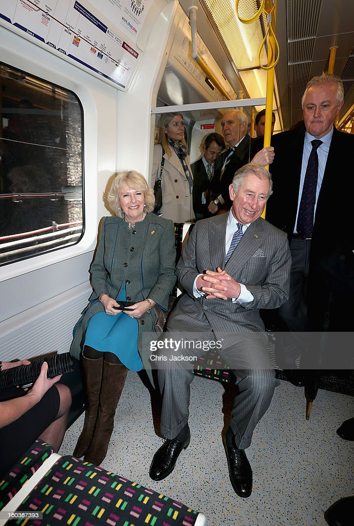 Camilla, Duchess of Cornwall and Prince Charles, Prince of Wales travel on a Metropolitan underground train from Farringdon to King's Cross as they mark 150 years of London Underground on January 30, 2013 in London, England.
