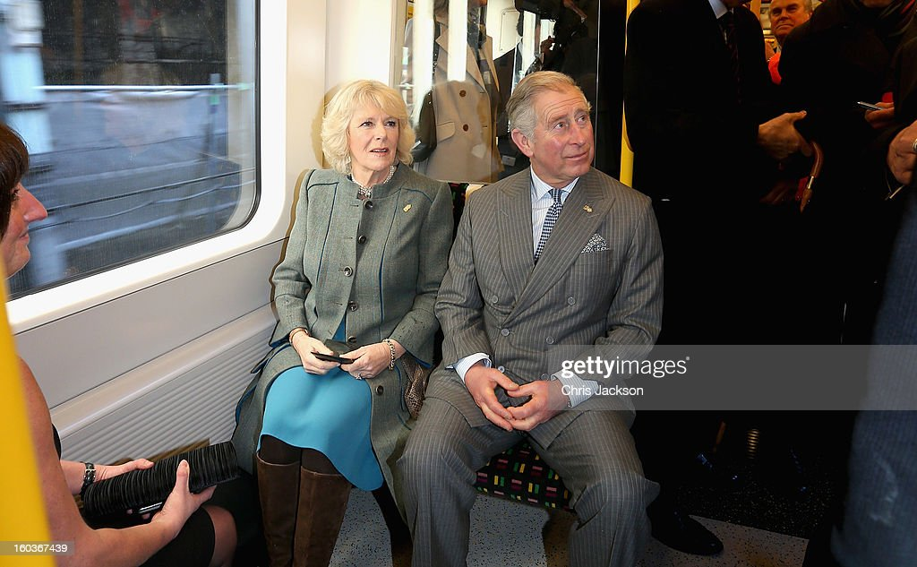 <a gi-track='captionPersonalityLinkClicked' href=/galleries/search?phrase=Camilla+-+Hertiginna+av+Cornwall&family=editorial&specificpeople=158157 ng-click='$event.stopPropagation()'>Camilla</a>, Duchess of Cornwall and Prince Charles, Prince of Wales travel on a Metropolitan underground train from Farringdon to King's Cross as they mark 150 years of London Underground on January 30, 2013 in London, England.