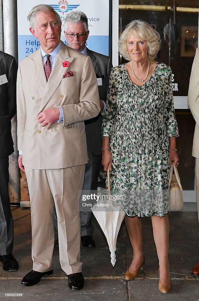 <a gi-track='captionPersonalityLinkClicked' href=/galleries/search?phrase=Camilla+-+Duchess+of+Cornwall&family=editorial&specificpeople=158157 ng-click='$event.stopPropagation()'>Camilla</a>, Duchess of Cornwall and <a gi-track='captionPersonalityLinkClicked' href=/galleries/search?phrase=Prince+Charles+-+Prince+of+Wales&family=editorial&specificpeople=160180 ng-click='$event.stopPropagation()'>Prince Charles</a>, Prince of Wales visit the Royal Flying Doctor Service on November 5, 2012 in Longreach, Australia. The Royal couple are in Australia on the second leg of a Diamond Jubilee Tour taking in Papua New Guinea, Australia and New Zealand.