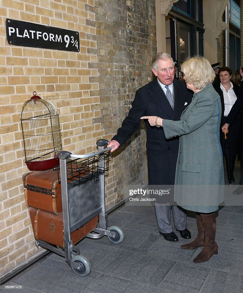 Camilla, Duchess of Cornwall and Prince Charles, Prince of Wales visit platform 9 3/4 at King's Cross Station during a visit to mark 150 years of London Underground on January 30, 2013 in London, England.