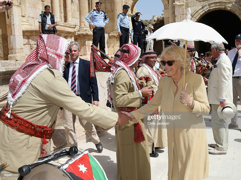 <a gi-track='captionPersonalityLinkClicked' href=/galleries/search?phrase=Camilla+-+Duchess+of+Cornwall&family=editorial&specificpeople=158157 ng-click='$event.stopPropagation()'>Camilla</a>, Duchess of Cornwall and <a gi-track='captionPersonalityLinkClicked' href=/galleries/search?phrase=Prince+Charles+-+Prince+of+Wales&family=editorial&specificpeople=160180 ng-click='$event.stopPropagation()'>Prince Charles</a>, Prince of Wales (R) visit the ancient Roman ruins in Jaresh on the third day of a visit to the country on March 13, 2013 in Jaresh, Jordan. The Royal couple are on the first leg of a tour of the Middle East taking in Qatar, Saudia Arabia and Oman.