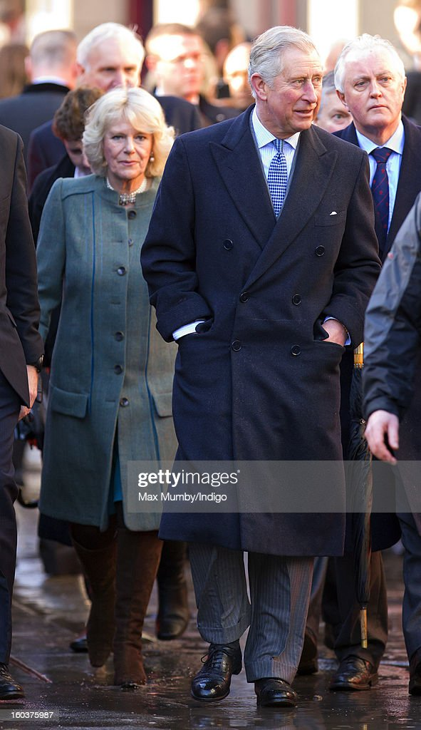 Camilla, Duchess of Cornwall and Prince Charles, Prince of Wales walk to Farringdon Underground Station, after viewing the nearby Crossrail development site, to travel on a Metropolitan line underground train to King's Cross on January 30, 2013 in London, England. The Prince of Wales and The Duchess of Cornwall are marking the 150th anniversary of London Underground to emphasise the importance of engineering and infrastructure development in the UK.