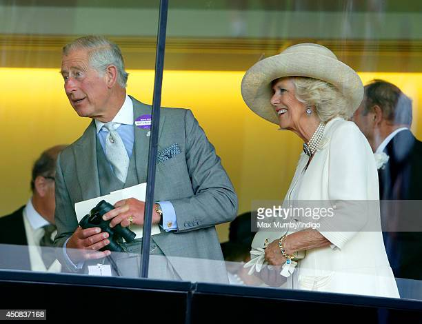 Camilla Duchess of Cornwall and Prince Charles Prince of Wales watch the racing as they attend Day 2 of Royal Ascot at Ascot Racecourse on June 18...