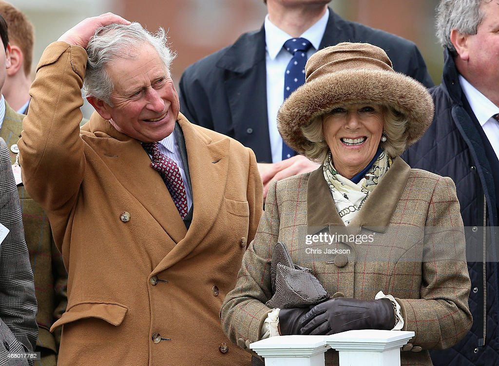 Camilla Duchess of Cornwall and Prince Charles Prince of Wales watch sheep jump over a fence during the 'Lamb National' at The Prince's Countryside...