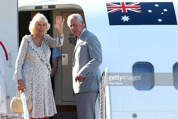 Camilla Duchess of Cornwall and Prince Charles Prince of Wales wave farewell before boarding a Royal Australian Airforce aircraft at Perth Airport on...