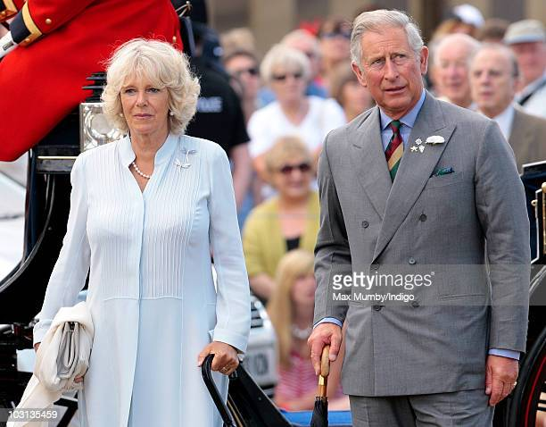Camilla Duchess of Cornwall and Prince Charles The Prince of Wales listen to the National Anthem as they arrive at the Sandringham Flower Show at...