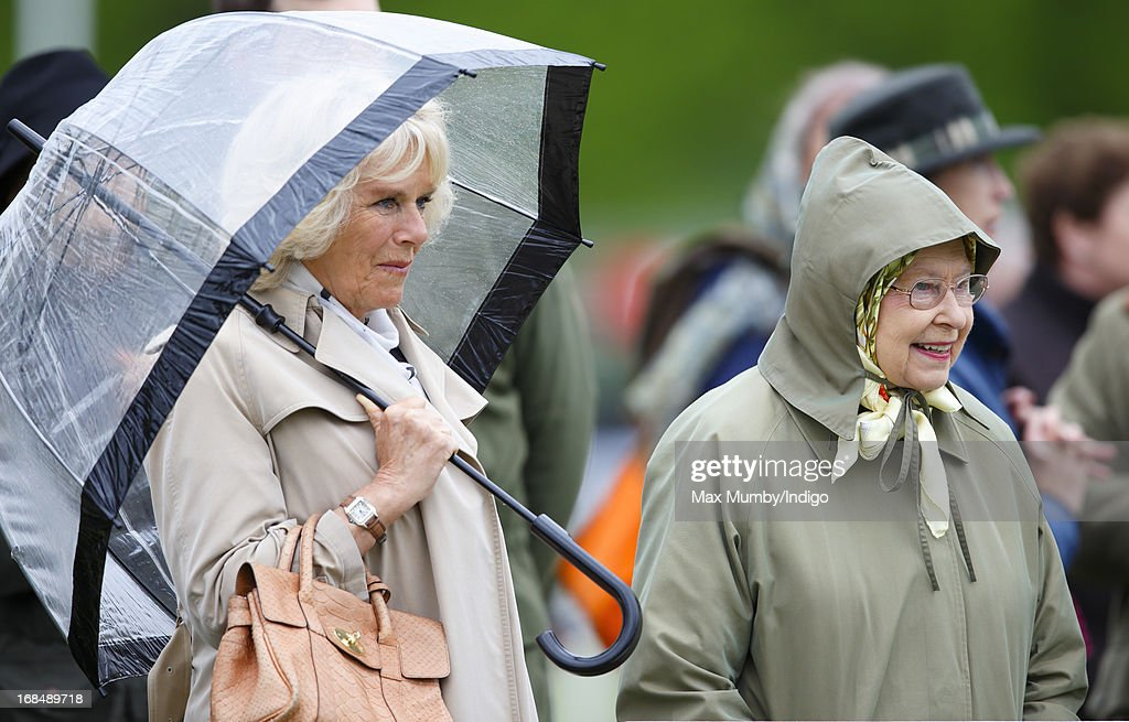 Camilla, Duchess of Cornwall and Queen Elizabeth II (R) watch one of Queen Elizabeth's horses compete in the Highland class on day 3 of the Royal Windsor Horse Show on May 10, 2013 in Windsor, England.