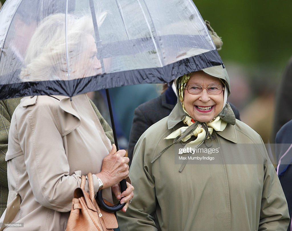 Camilla, Duchess of Cornwall and Queen Elizabeth II watch one of Queen Elizabeth's horses compete in the Highland class on day 3 of the Royal Windsor Horse Show on May 10, 2013 in Windsor, England.