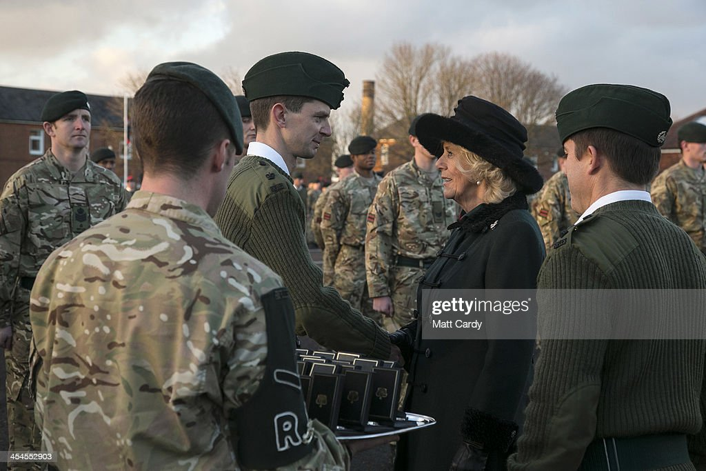 Camilla, Duchess of Cornwall arrives to present medals to soldiers from the 4th Battalion The Rifles to mark their return from Afghanistan, at their barracks in Bulford on December 9, 2013 in Wiltshire, England.