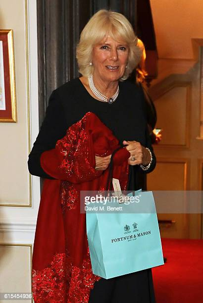 Camilla Duchess of Cornwall attends the launch of 'Fortnum Mason The Cook Book' by Tom Parker Bowles at Fortnum Mason on October 18 2016 in London...