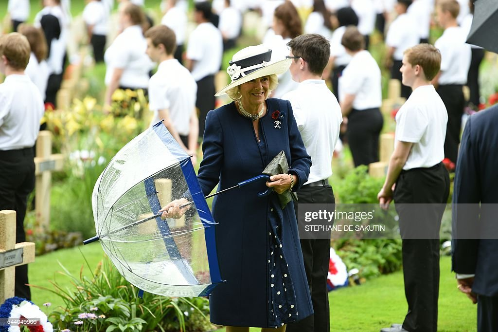 Camilla, Duchess of Cornwall (C) attends the memorial ceremony on July 1, 2016, in Thiepval, during which Britain and France will mark the 100 years since soldiers emerged from their trenches to begin one of the bloodiest battles of World War I (WWI) at the River Somme. Under grey skies, unlike the clear sunny day that saw the biggest slaughter in British military history a century ago, the commemoration kicked off at the deep Lochnagar crater, created by the blast of mines placed under German positions two minutes before the attack began at 7:30 am on July 1, 1916. / AFP / POOL / STEPHANE
