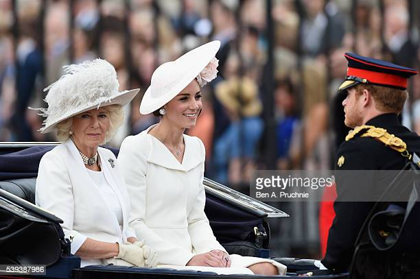 Camilla Duchess of Cornwall Catherine Duchess of Cambridge and Prince Harry sit in a carriage during the Trooping the Colour this year marking the...