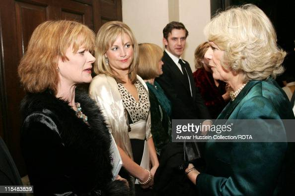 HRH Camilla Duchess of Cornwall chats to actress Samantha Bond one of the presenter's of 'The Story of Christmas' at StGeorge's Church on December 19...