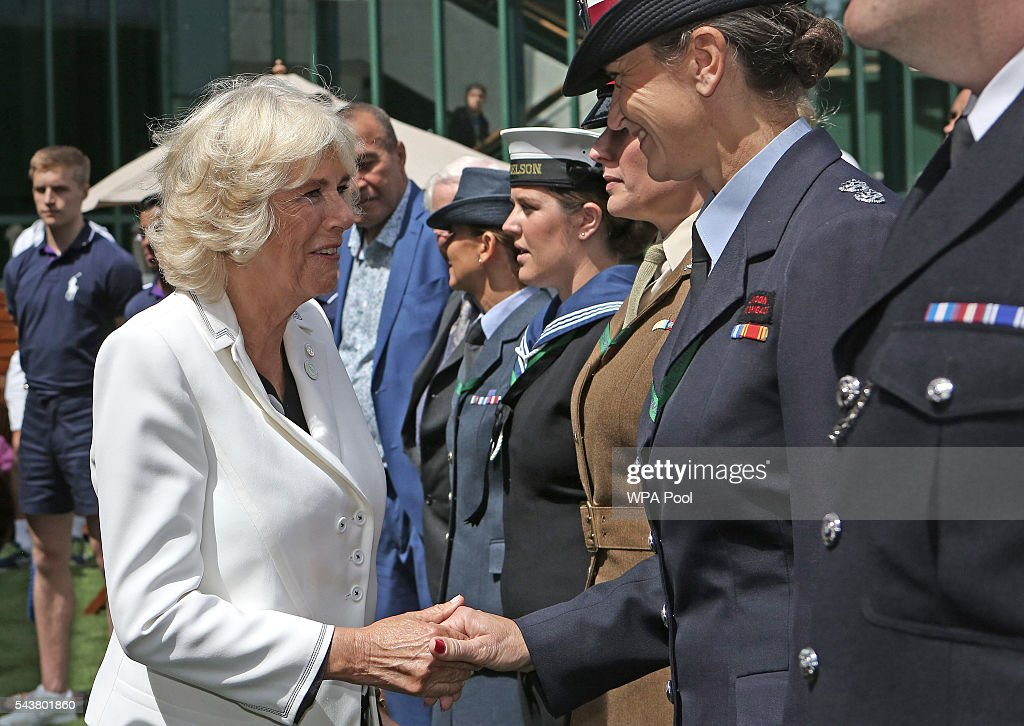 <a gi-track='captionPersonalityLinkClicked' href=/galleries/search?phrase=Camilla+-+Duchess+of+Cornwall&family=editorial&specificpeople=158157 ng-click='$event.stopPropagation()'>Camilla</a>, Duchess of Cornwall chats to armed forces personnel during a visit to the Lawn Tennis Championships at the All England Lawn Tennis Club on June 30, 2016 in London, England.